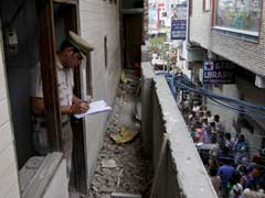 One Person Stand Guard While Others Hang: Note At Delhi Family's Home
