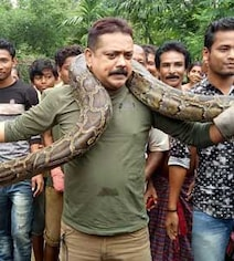 Foreign Media On Bengal Officer Almost Getting Choked By Python