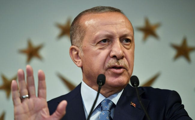 Turkey sacks thousands through emergency decree as Erdogan cements power