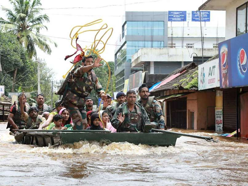 Rescuers plead for help as thousands stranded in flooded Kerala
