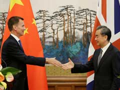 China Tempts Britain With Free Trade, Says Door To US Talks Open