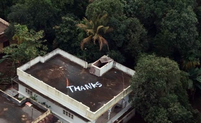 'Thanks' Painted On Rooftop Where Pregnant Woman Was Rescued By Navy