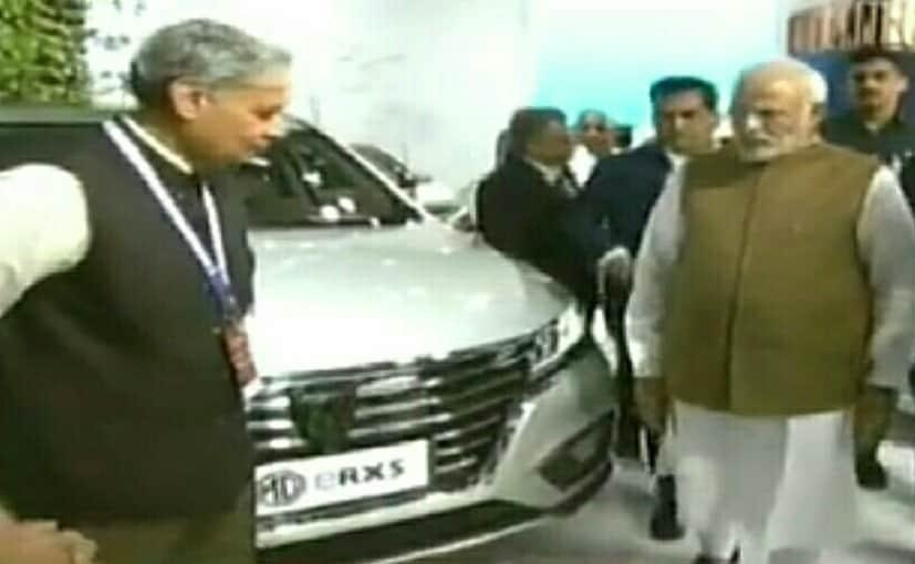 Prime Minister Narendra Modi checks out the MG ERX5 electric SUV