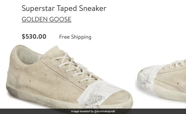 Expensive pair of taped sneakers slammed for glorifying poverty