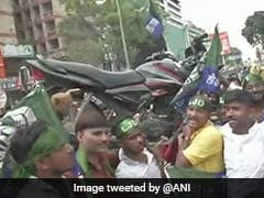 "In Bharat Bandh, Motorcycle On Shoulders To Show ""Weight"" Of Fuel Price"