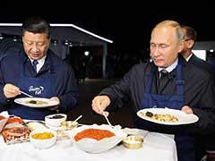 Vladimir Putin, Xi Jinping Don Aprons, Flip Pancakes At Economic Forum