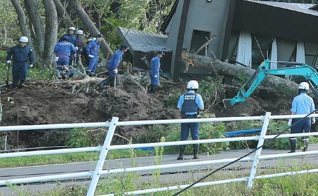 35 Dead In Japan Earthquake; Rescue Workers Rake Through Mud For Survivors
