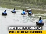 Video : Watch: Kids Cross River In Aluminium Pots To Reach School In Assam