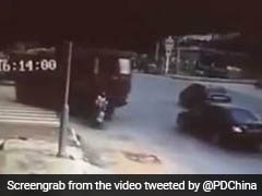 Chinese Woman On 2-Wheeler Run Over By Truck, Then Gets Up And Walks Away