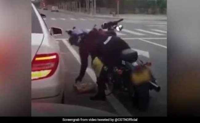 Woman Throws Garbage Out Of Car Window. Watch What A Biker Does Next