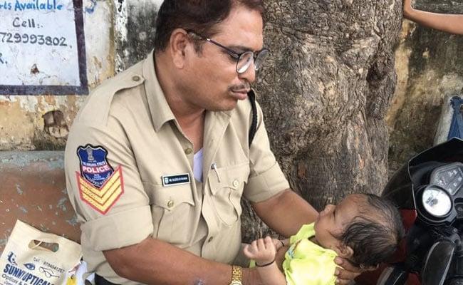 Telangana Cop Babysits While Mother Writes Exam, Wins Hearts