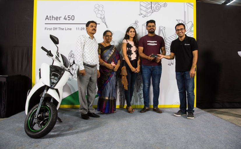Tarun Mehta, CEO, Ather Energy with first Ather 450 scooter recipient, Aditya Reddy and family
