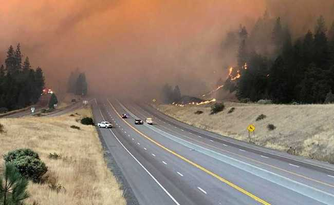 Crews Fight To Control Raging Wildfire In Northern California