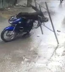 In Chilling CCTV Footage, Iron Frame Falls On Biker's Head In Bengaluru