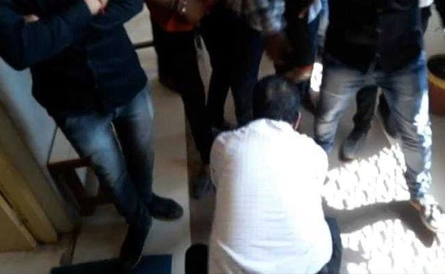 In A Bid To Stop Slogans Near Class, Professor Touches Protesters' Feet