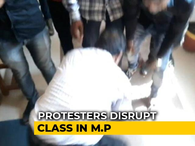 Video : Professor Touches Feet Of Protesters Who Called Him 'Anti-National'