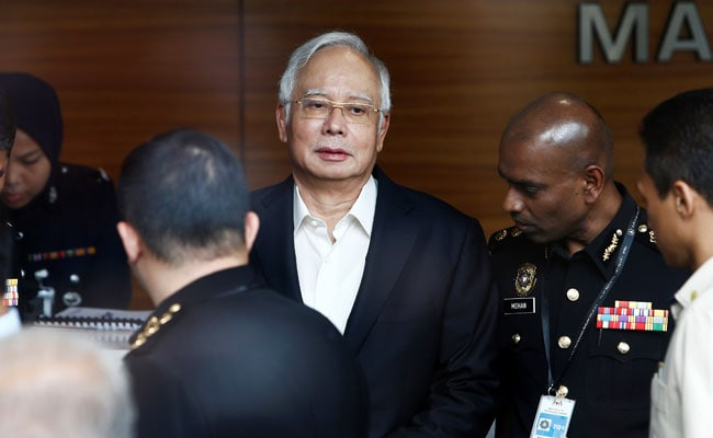 Former Malaysian PM Najib charged with criminal breach of trust