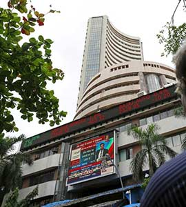 Sensex Ends Marginally Higher, Nifty Hits Record Peak