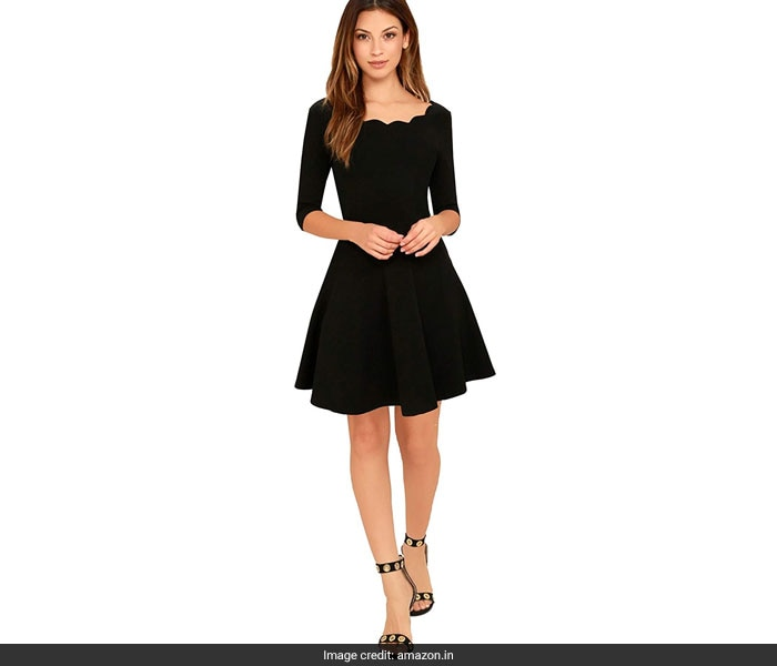eee9f77ac8bb5 This lace detailed little black dress has our hearts. We love the delicate  lace detailing all over the dress and the sheer panels along the neck and  the ...