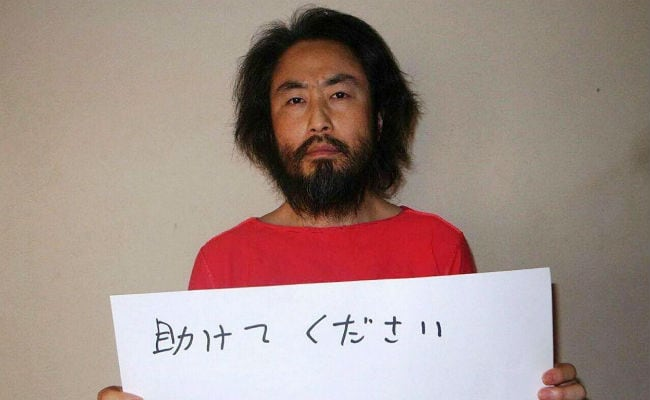 Japan reporter freed from Syria happy to go home from 'hell'