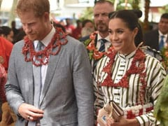 Prince Harry, Meghan Wrap Up Pacific Island Trip Wearing Matching Skirts