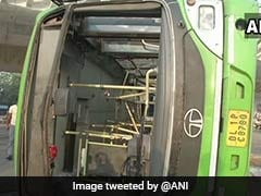 9 Injured As DTC Bus Overturns After Being Hit By Truck