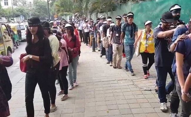 Blindfolded, Hundreds Walked Behind The Visually Impaired In Bengaluru