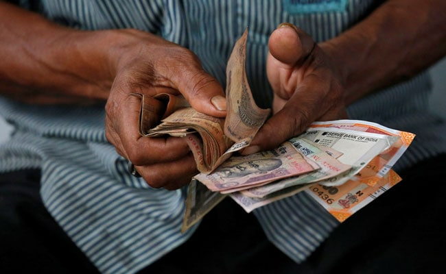Rupee Edges Lower To Close At 71.07 Against Dollar�