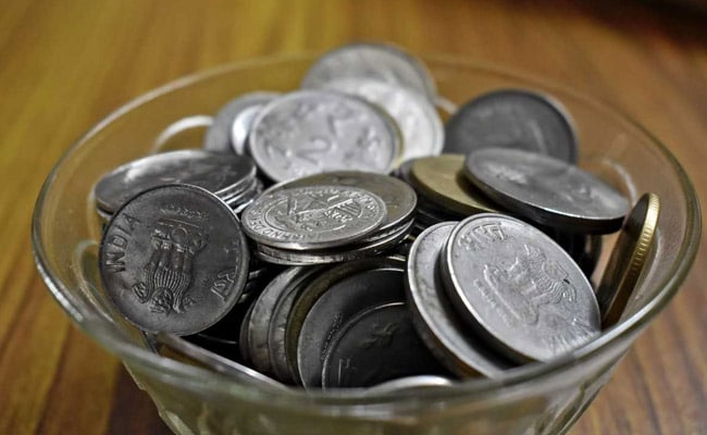 Rupee Closes Lower At 69.42 Against Dollar