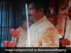 Deepika-Ranveer Wedding: रणवीर सिंह पर खूब जची शेरवानी, दीपिका पादुकोण ने काली छतरी से छिपाया चेहरा