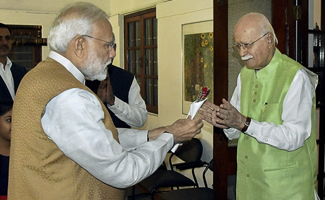 PM Modi Visits LK Advani To Wish Him Birthday Gifts Flower