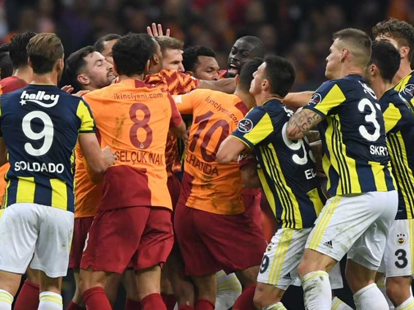 Watch: Fenerbahce Midfielder Chased Off The Pitch During Mass Brawl In Istanbul Derby