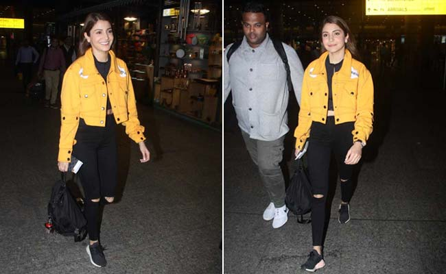 In a bright yellow jacket, up to a winter style game like Anushka Sharma