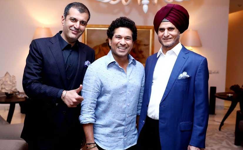 Sachin Tendulkar with Neeraj Kanwar, Vice Chairman & MD & Onkar S Kanwar, Chairman, Apollo Tyres