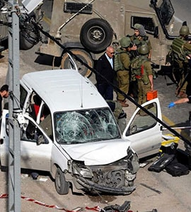 Israeli Policemen Inspect The Scene Of A Car Ramming Attack Near Hebron