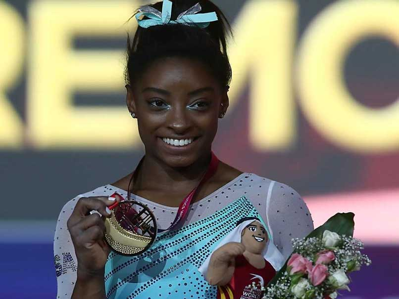 Unstoppable Simone Biles Claims Record Fourth All Around World Title