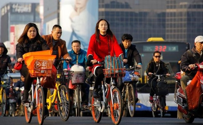China's population set to peak at 1.44 billion in 2029t Shanghai Reuters