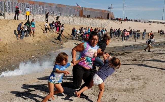 Honduran Migrant Clutches 2 Children, Flees Tear Gas At US-Mexico Border