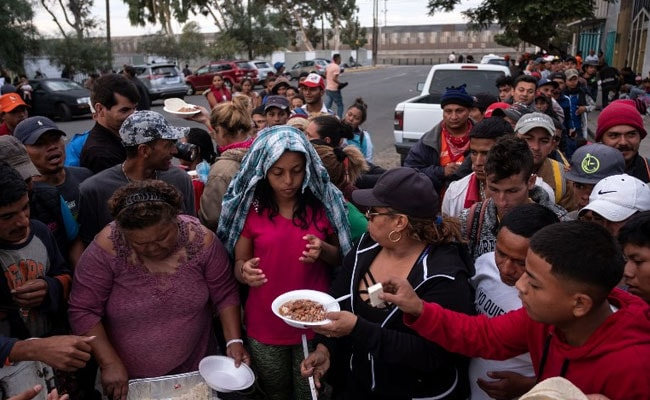 Migrant Caravan Arrives At US-Mexico Border