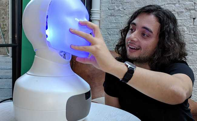 Robot With 'Human-Like Face' Smiles, Encourages People To Interact