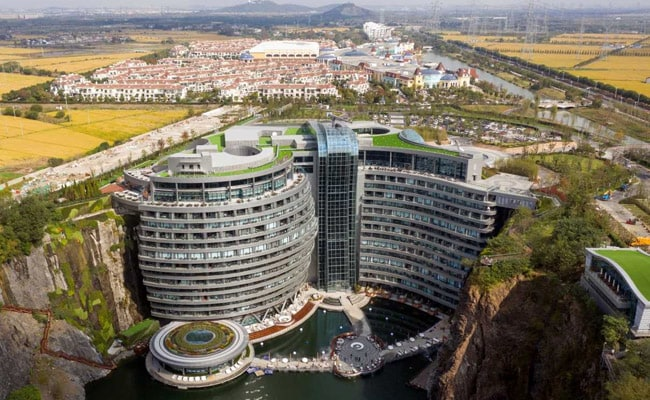 Inside China's Swanky Hotel Built In A Pit, With Suites Below Water Level