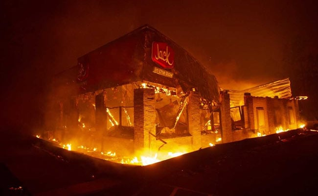 Late-Season Wildfire Ravages California Town As Residents Flee