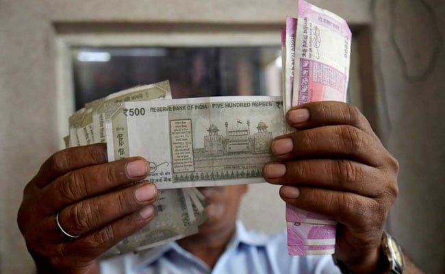 Rupee Drops By 22 Paise Against Dollar
