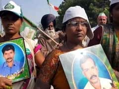 Holding Photographs Of Husbands, Widows Of Farmers Protest In Delhi