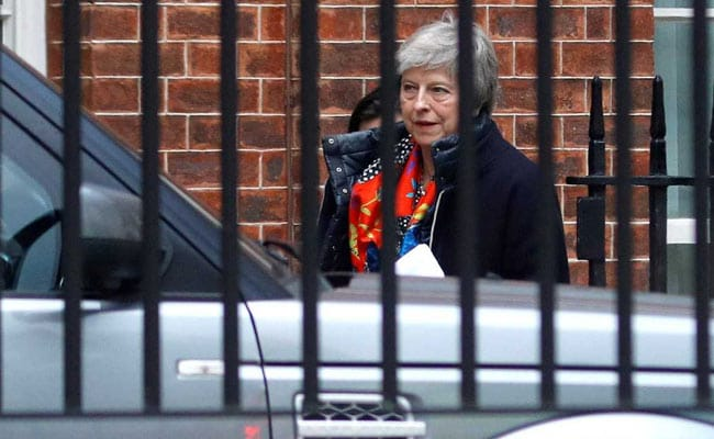 Theresa May Survives, Weakened And With An Exit Date