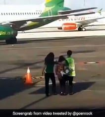 Woman Tries To Chase Down Plane After Missing Her Flight. Video Is Viral