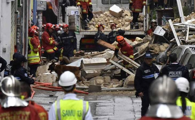 French rescuers find body in ruins of collapsed buildings
