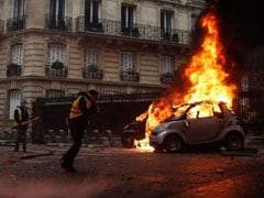 France Scraps Fuel Price Hikes After Weeks Of Protests, Calls For Calm