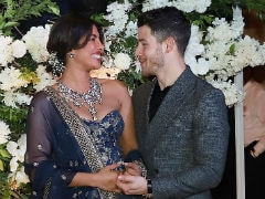 Priyanka Chopra And Nick Jonas Can't Stop Being Cute At Their Mumbai Reception