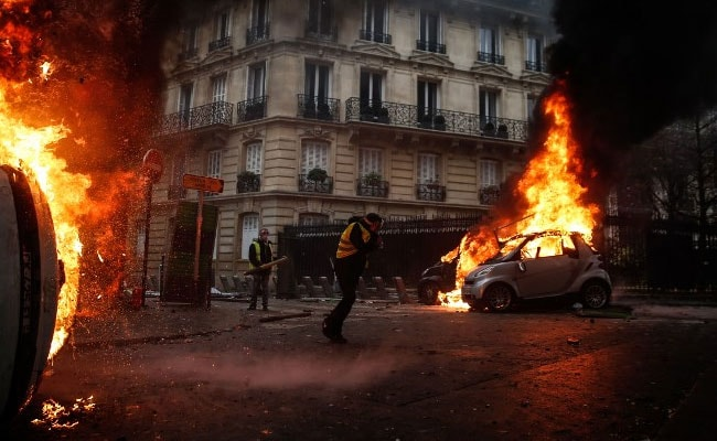 France abandons petrol tax rises after deadly protests